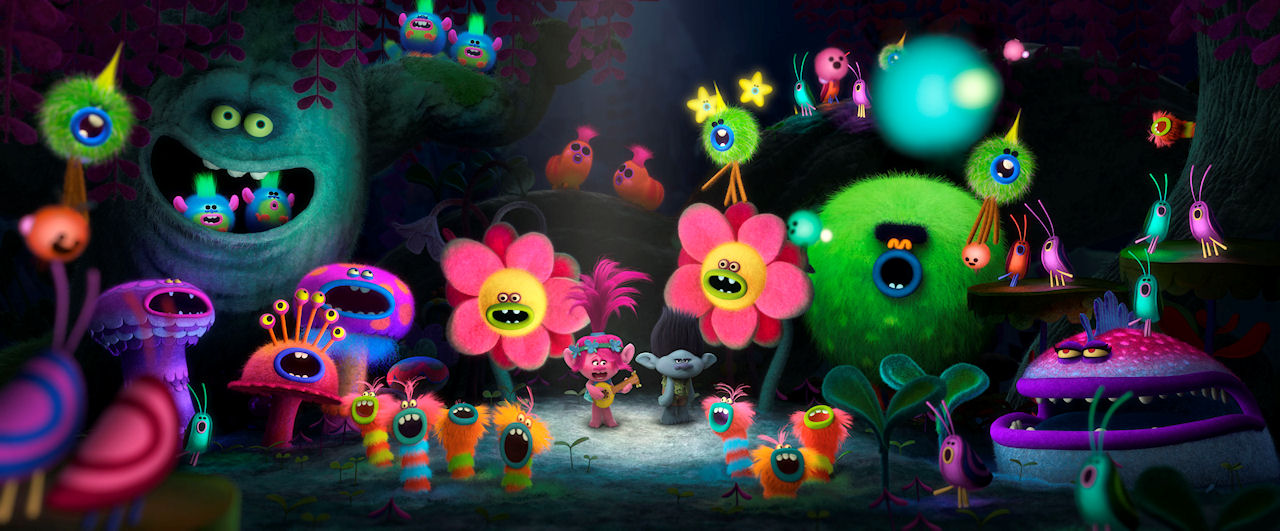 Poppy (center left with guitar, voiced by Anna Kendrick) and Branch (center right, voiced by Justin Timberlake) in DreamWorks Animation's TROLLS. (Photo courtesy of DreamWorks Animation)