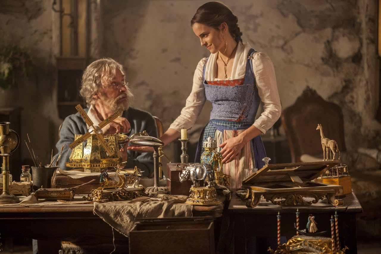Kevin Kline stars as Maurice and Emma Watson as Belle in BEAUTY AND THE BEAST. (Photo by Laurie Sparham / courtesy of Disney).