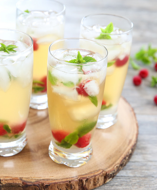 photo of glasses of Iced Green Tea Mojitos on a wooden board
