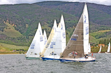 J/24 one-design sailboats- sailing upwind on lake