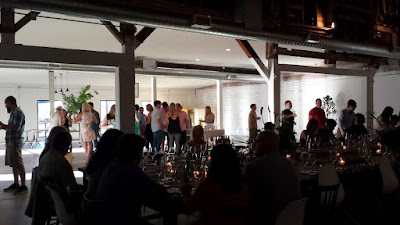 The mingling of guests while enjoying a glass of Brooks Winery white during the First course of passed hors d'oeuvres at the Jacobsen Salt Co Salt Fire Water dinner #3 with Ivan Ramen + Lang Baan