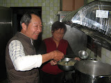 Zhao Baba preparing a meat at the Home of God's Love