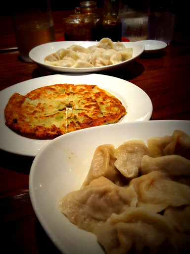Dumplings and one of many scallion pancakes we ordered at Oh! Dumplings in Montreal - one of the best meals I ate this year