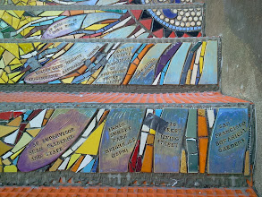 "Photo: Detail of bottom half of passion flower (the ""Gratitude"" element, thanking organizations and businesses that provided substantial support and in-kind gifts) on the fourth flight of steps (from bottom) of the Hidden Garden Steps (16th Avenue, between Kirkham and Lawton streets in San Francisco's Inner Sunset District) installed on October 31, 2013. KZ Tile workers finished installing more than 80 pieces of the 148-step ceramic-tile mosaic designed and created by project artists Aileen Barr and Colette Crutcher. For more information about this volunteer-driven community-based project supported by the San Francisco Parks Alliance, the San Francisco Department of Public Works Street Parks Program, and hundreds of individual donors, please visit our website at http://hiddengardensteps.org."