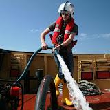 Crew member using the salvage pump