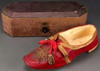 The History and Symbolism of the Pope's Red Shoes