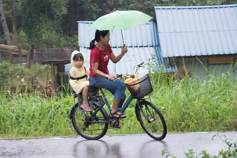 Cycling while holding umbrella