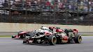 Heikki Kovalainen, Lotus E21 Renault, passes Sergio Perez, McLaren MP4-28 Mercedes