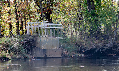 The remains of the bridge abutement below Lake Henry at the north end of Ramapo reservation. Good ridance. Hope they replace it at least several  feet higher.