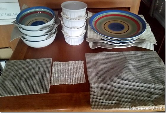 Put shelf liners between glass dishes