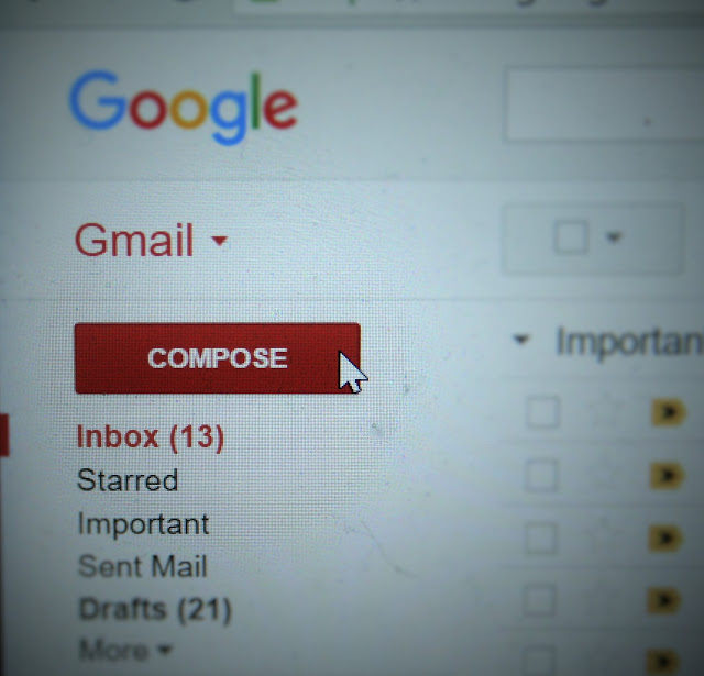 Email client showing compose button.