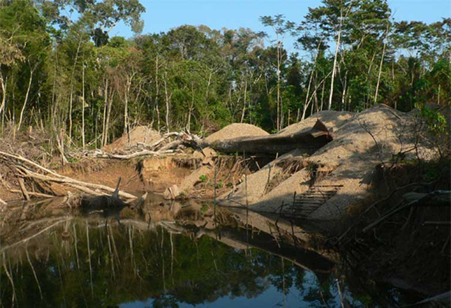 A flooded gold mine in Madre de Dios, Peru. The study reviewed multiple human impacts on freshwater ecosystems, including dam-building, mining, land-cover change, and climate change. Individually, each of these can cause harm and alter how the ecosystem functions, but the scientists warn that they will also interact, with 'the potential to trigger cascading effects that can significantly degrade these freshwater ecosystems.' Photo: Claire Salisbury