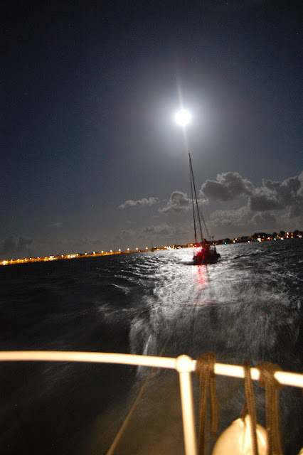 No, it's not the navigation light on top of the yacht being towed by Poole all-weather lifeboat. It's the supermoon, bigger and brighter, lighting up the way as the lifeboat tows the yacht towards Poole Quay Boat Haven after a 6-hour call out. 10 August 2014 Photo: RNLI Poole/Dave Riley