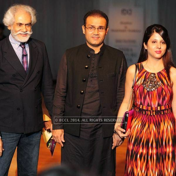 Sunil Sethi, Virendra Sehwag and Arti Sehwag during the Rimple and Harpreet show on Day 6 of India Couture Week, 2014, held at Taj Palace hotel, New Delhi.
