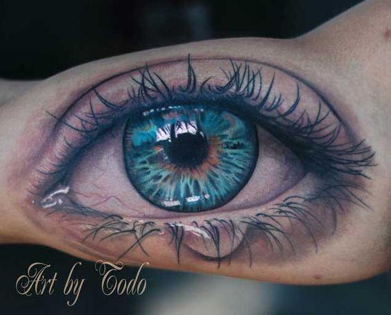bela_triste_olho_braço_de_tatuagem