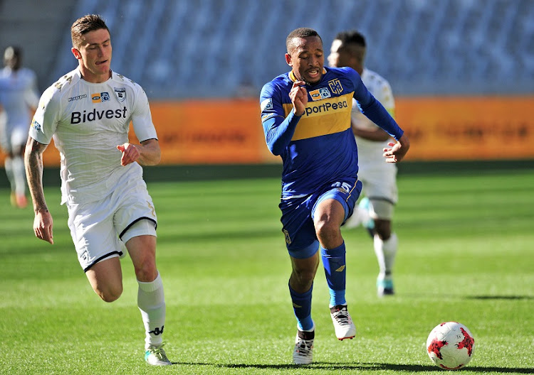 Lehlohonolo Majoro of Cape Town City is chased by Slavko Damjanovic of Bidvest Wits during the 2017 MTN8 Semifinal 1st leg fixture between Cape Town City and Bidvest Wits at Cape Town Stadium on 27 August 2017.