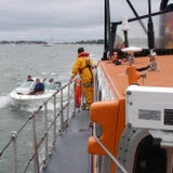 29 May 2011 - The ALB escorts a speedboat with intermittent engine failure back towards the Baiter slipway