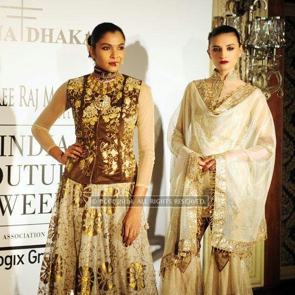 Model pose for Rina Dhaka on Day 2 of India Couture Week, 2014, held at Taj Palace hotel, New Delhi.