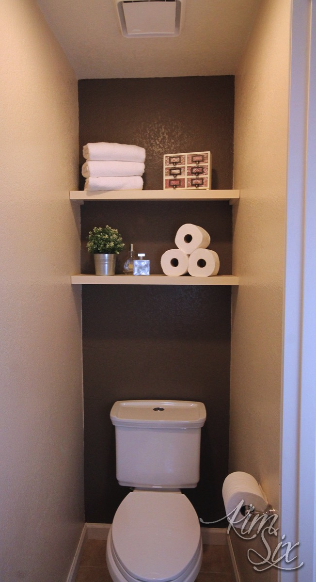 Water Closet with Brown Accent Wall