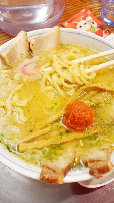 The first ramen place we decide to try at Shin Yokohama Eamen Museum is at the shop Ryu Shanghai Honten, whose trademark is in its super-fat noodles folded over 32 times and that their spicy miso ramen is topped off with a scoop of the raw, spicy-hot miso