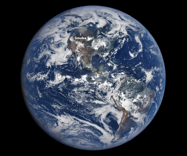 On 15 August 2018, smoke from wildfires in Canada was so pronounced it was visible from a distance of about 1.5 million kilometers (1 million miles) away. That's the distance of NASA's Earth Polychromatic Imaging Camera (EPIC) on NOAA's DSCOVR satellite, which acquired this image on 15 August 2018. Photo: Lauren Dauphin / NASA Earth Observatory