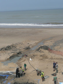 Archaeological dig on Happisburgh beach
