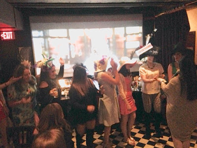 women in funky hats for a kentucky derby party in boston's back bay