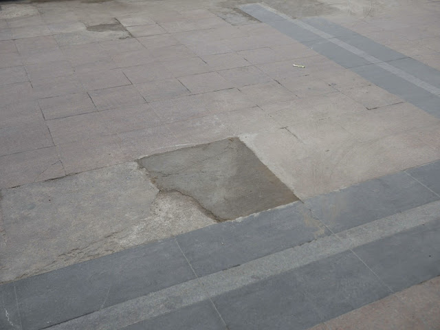 a flat unmarked patch of dried cement