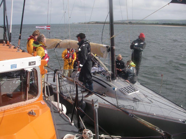 Poole all-weather lifeboat  alongside a 6m yacht that had lost its rudder. Photo: RNLI Poole/Dave Riley