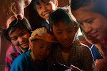 They love the camera! At the local village in Myanmar.