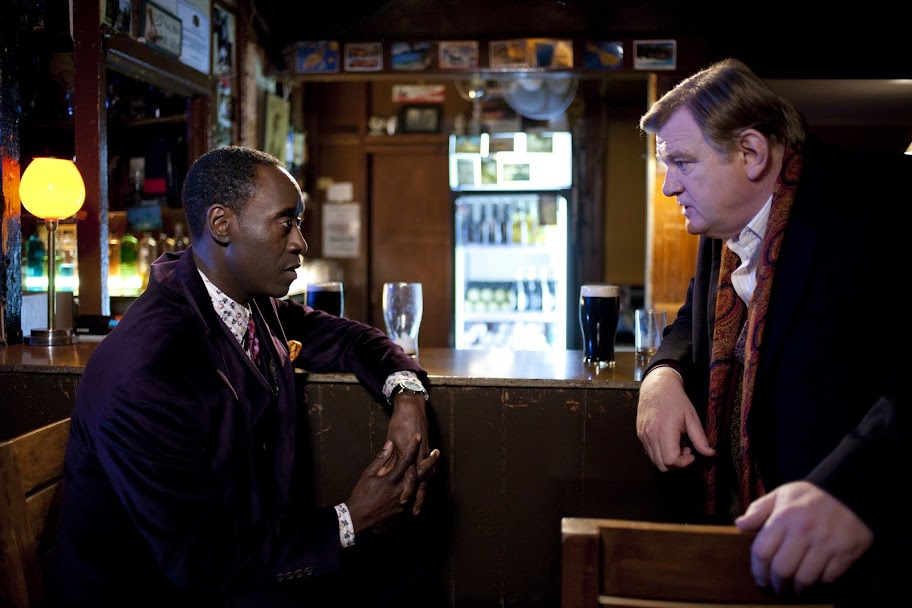 Don Cheadle and Brendan Gleeson in THE GUARD