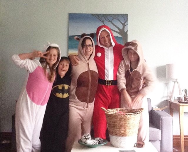 Our crazy tribe in our Christmas Onesies