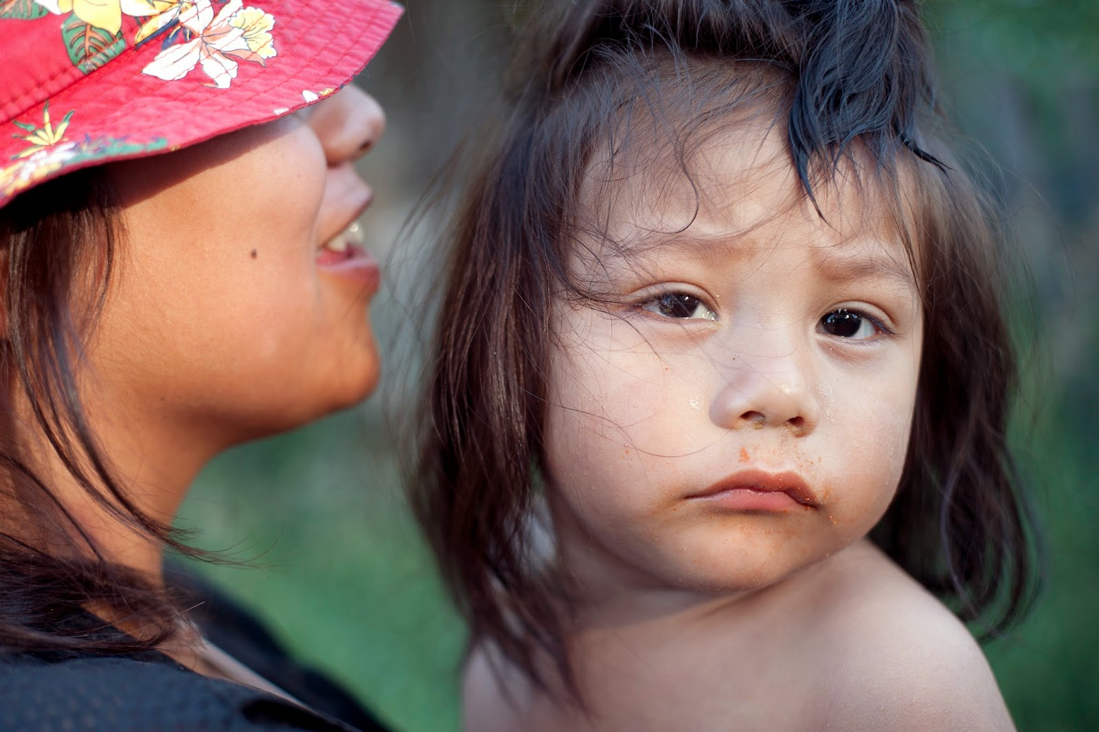 Lodge Grass, Montana.Violita Fouler (Gun Shows) holds her younger brother. Violita and all 7 of her family members share a two bedroom trailer. This type of housing situation is common and in the 2000 Census the Reservation had a near 30% poverty rate.