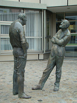 sculpture of two people discussing