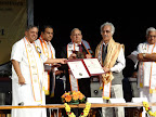 Dr.Madan Mohan being awarded the Doctor of Science by Vice Chancellor Dr.H.R.Nagendra and the Chief Guest Dr.S.C.Sharma