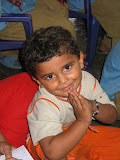 A small primary school pupil says 'namaste' to visitors.