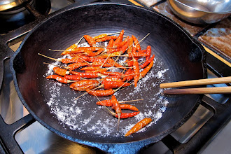 Photo: toasting dried red Thai chillies