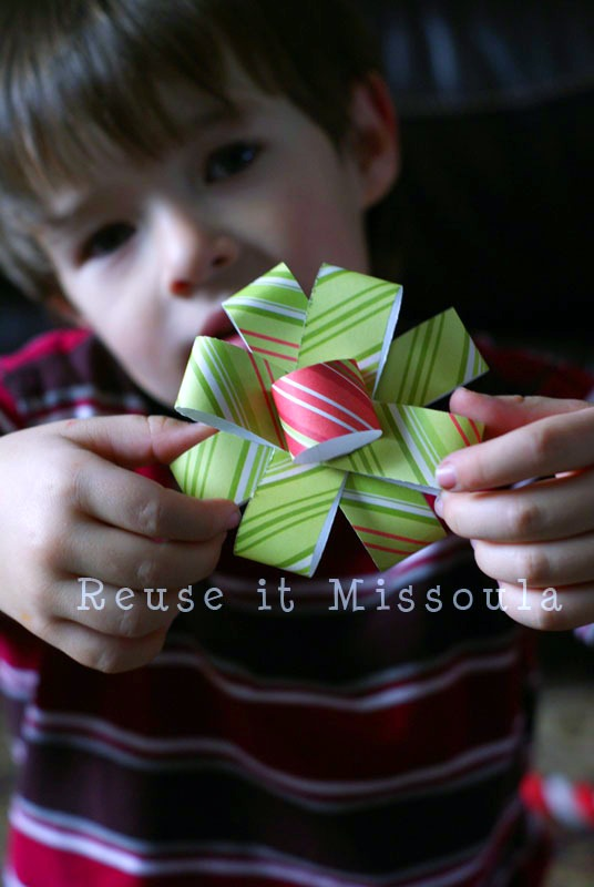 Lisa's son shows off a recycled Christmas bow.