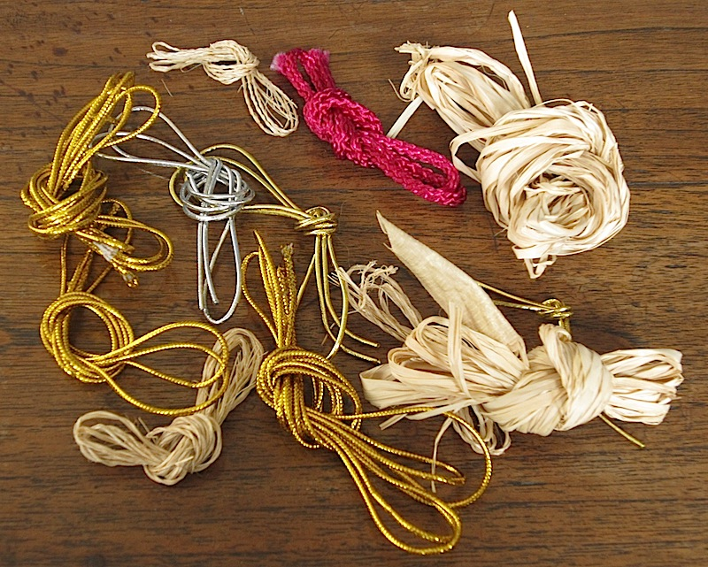 lightly knotted used cords, string and yarn