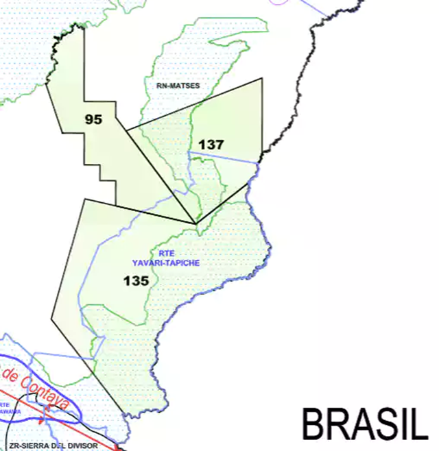 "Detail from a Perupetro May 2014 map showing how oil concessions Lot 135 and Lot 137 (black boundaries) overlap the proposed Yavari-Tapiche reserve (sky blue boundaries) for indigenous peoples living in ""isolation."" The map also shows how the concessions overlap two ""protected natural areas"": the Matsés national reserve and the then Sierra del Divisor reserved zone (green boundaries), now a national park. The proposed Yavari-Tapiche reserve no longer appears on Perupetro's current publicly available concessions map. Graphic: Perupetro"