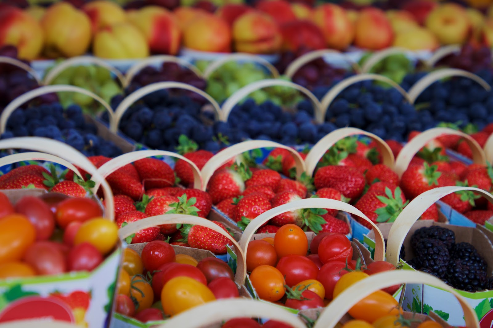 Farmers market stand with berry baskets