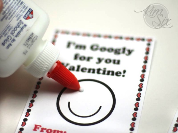 Gluing on google eyes to valentine