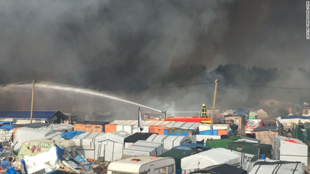Firefighters struggle to control the dozens of fires tearing through the refugee camp in Calais known as 'the Jungle', 26 October 2016. Photo: Saskya Vandoorne / CNN