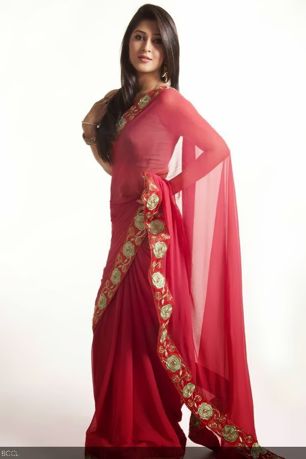 Sonarika goes traditional in delicate pink sari during a photoshoot.