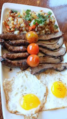 Ya Hala Lebanese Brunch big plate of lebanese country breakfast house-smoked lamb bacon, house soujouk, fried egg, potato-mint hash