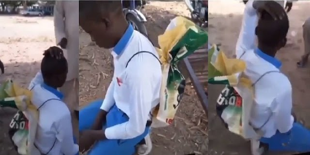 Heartbreaking video of a student being mocked by his teachers because he used rice sack as school bag [Video]