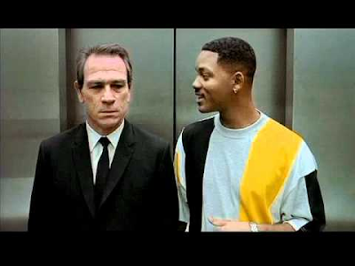 Agent K and James Edwards III, soon to become Agent J, in an elevator. Scene from movie: Men in Black