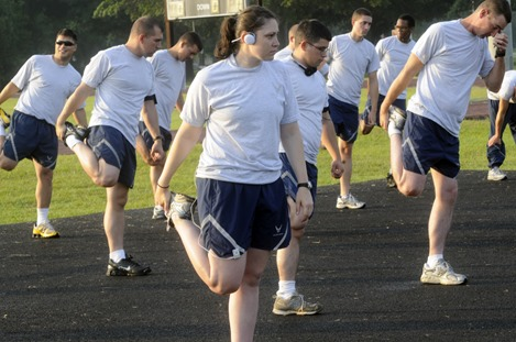 Members of the 52nd CBCS do stretching exercises during PT June 10. U. S. Air Force photo by Sue Sapp