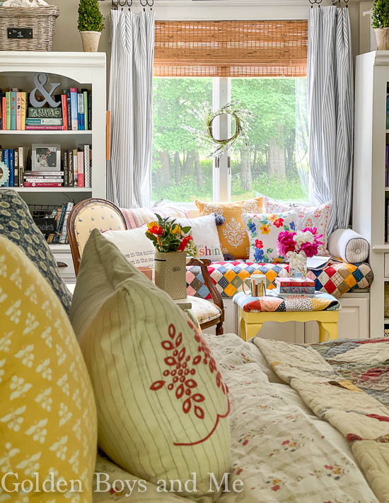 Colorful quilts in DIY window seat - www.goldenboysadme.com
