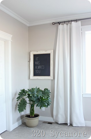 master bedroom plant and chalkboard